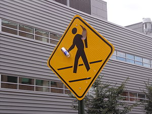 English: A pedestrian crossing sign that has b...