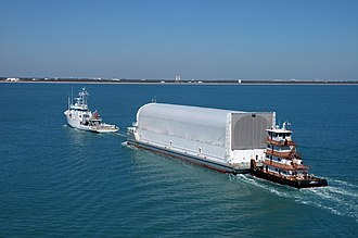 Space Shuttle external tank - The Pegasus barge carrying ET-119 is towed to Port Canaveral.