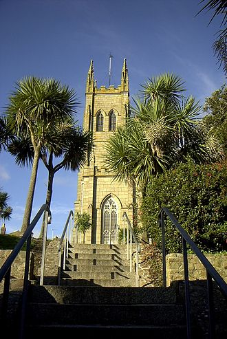 """Flora and fauna of Cornwall - Cornwall is known for its """"Cornish palm"""" (Cordyline australis). These examples are at St Mary's Church, in Penzance"""