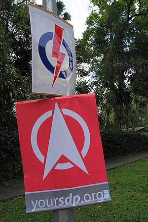 General elections in Singapore - Posters of the People's Action Party (top) and Singapore Democratic Party hung from a lamppost on Clementi Road in Holland–Bukit Timah GRC during the 2011 general election