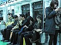People engaging with their phones on the Seoul Metro - 5166351572 4e33242d3e o.jpg