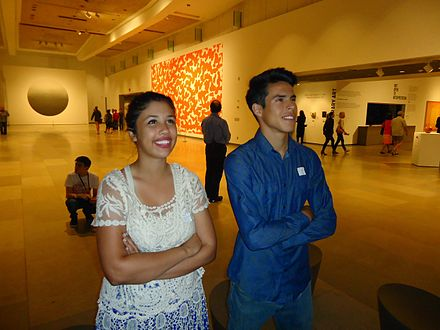 One of the main exhibition rooms. Phoenix young couple looking at artwork at Phoenix Art museum.JPG