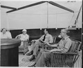 Photograph of President Truman relaxing on the fantail of his yacht, the U.S.S. WILLIAMSBURG, during his vacation... - NARA - 199028.tif