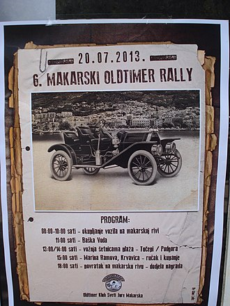 Antique car - An antique car on a poster advertising a race in Makarska, Croatia