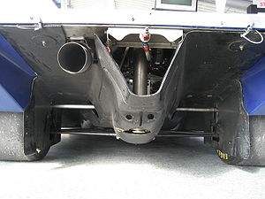 Porsche 962 - The rear diffuser of an IMSA-spec 962. The exhaust pipe and rear suspension are within the Venturi tunnels, while the gearbox and airjacks are in the center shroud.