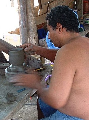 Potter's wheel - Potter in Guatil, Costa Rica, using a hand-powered wheel, 2003