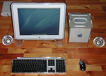 An Apple Studio Display connected to a Power Mac G4 Cube