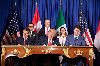Mexican President Pena Nieto, U.S. President Trump, and Canadian Prime Minister Trudeau sign the United States-Mexico-Canada Agreement during the G20 summit in Buenos Aires, Argentina, on 30 November 2018 President Donald J. Trump at the G20 Summit (44300765490).jpg