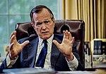 President George H. W. Bush at his Oval Office desk.jpg