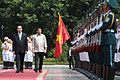 President Rodrigo Duterte, accompanied by Vietnamese President Tran Dai Quang, walks past the honor guards during an official visit on September 29.jpg