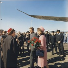 President and Mrs. Kennedy arrive at Dallas. President Kennedy, Mrs. Kennedy, others. Dallas, TX, Love Field. - NARA - 194273.tif