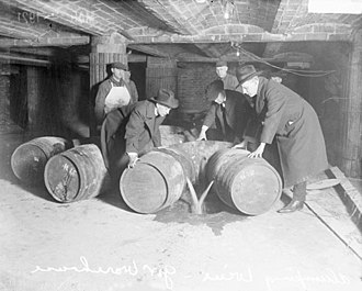 New Jersey wine - Prohibition agents destroying barrels of alcohol, circa 1921