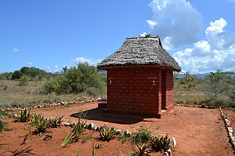 Public toilets from outside the main gate of the LUMO Community Wildlife Sanctuary in Kenya.jpg