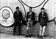 Punks on brick wall c1984