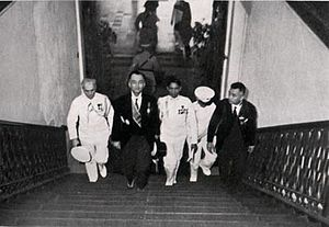 Tomas Morato - President Manuel L. Quezon (1935-1944) climbs up the grand staircase of Malacañan Palace with aide-de-camp Col. Manuel Nieto and Presidential Guard Battalion Commander Col. Manzano.