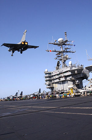 A Rafale M flies above the aircraft carrier US...
