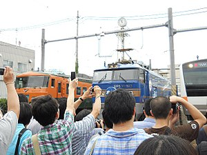 Railfan - Railfans taking train photos at the Japan Railways Group (JR) Tokyo train center