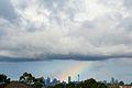 Rainbow over the Sydney CBD (9582817886).jpg