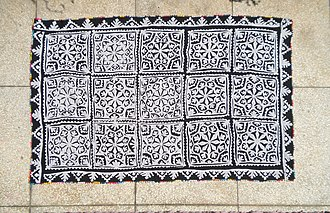 Ralli quilt - An appliqué ralli quilt in two colors