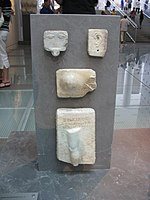 Relief votive offerings from the Asclepieion.jpg