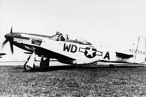 "Pierce McKennon - Pierce McKennon in his P-51D-20-NA Mustang 44-72308 nicknamed ""Ridge Runner III""."