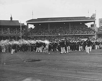 Ron Clarke carrying the Olympic Torch through the MCG at the 1956 Olympic Games' opening ceremony. Ron Clarke carrying the Olympic Torch during opening ceremony at Melbourne Olympic Games.jpg