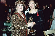 Metcalf and Rosie O'Donnell holding an Emmy