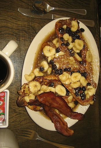 Bananas Foster French toast with bacon. Ruby S...