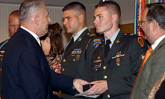 Russell Adam Burnham - Spc. Russell A. Burnham, right, receives U.S. Army Soldier of the Year Award (2003)