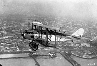 Standard J - Standard J, modified with an enclosed cabin by T. Claude Ryan, in flight over San Diego