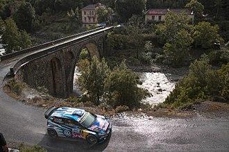 2019 Tour de Corse - Sébastien Ogier and Julien Ingrassia driving a Volkswagen Polo R WRC through Corsica's twisty asphalt-surfaced road.