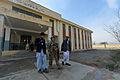 SSgt Elizabeth Rosato 755th ESFS with Afghan school officials.JPG