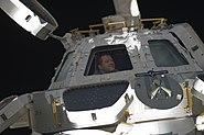 STS-130 Nicholas Patrick looks through Cupola