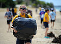 Sailors help with beach clean-up in Okinawa, Japan. (9619991057).jpg