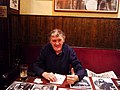 "Sam Leach (Liverpool promoter) signs his book ""The Birth of the Beatles"", at The Grapes, Mathew Street, Liverpool, 2008.jpg"