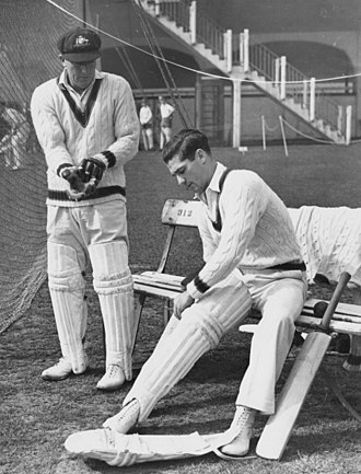 Sam Loxton with the Australian cricket team in England in 1948 - Loxton congratulates Harvey with his first century in a Test against England