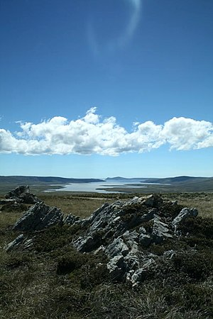 Geography of the Falkland Islands - San Carlos Water, one of many inlets on East Falkland. The islands are heavily indented by sounds and fjords