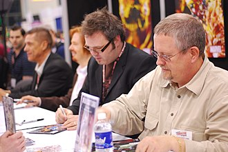 Orson Scott Card - Card (right) signing autographs at New York Comic Con in 2008