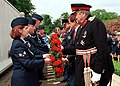 Senior airman (left) passes a wreath to Her Majesty's Lord Lieutenant of Cambridgeshire James Crowden during the Madingley memorial day commemorative service.jpg
