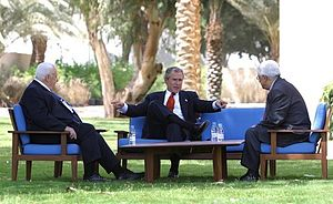 Israeli–Palestinian peace process - President George W. Bush, center, discusses the peace process with Prime Minister Ariel Sharon of Israel, left, and Palestinian President Mahmoud Abbas in Aqaba, Jordan, 4 June 2003.