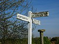 Signpost and inscribed stone at Longcross - geograph.org.uk - 392521.jpg