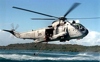 Sikorsky UH-3H Sea King of VC-8 hovers off Naval Station Roosevelt Roads on 17 March 1997 (970317-N-8977R-006).jpg