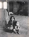 Singwa, Suyoc Igorrote boy and his aunt in the Philippine Reservation in the Department of Anthropology at the 1904 World's Fair.jpg
