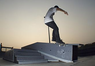 Grind (skateboarding) - A skateboarder performing a Smith grind