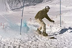 Snowboarder in France mastering mixed style.