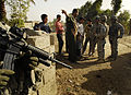 Soldiers meet with local residents to address concerns DVIDS58546.jpg