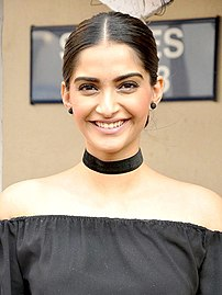 A picture of Sonam Kapoor during promotions of the film Neerja as she looks at the camera.