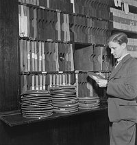 Sound archives. An unknown man handles tapes in tape library..jpg