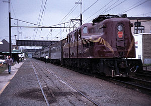 NJ Transit - A PRR GG1, built for the Pennsylvania Railroad in the 1930s–1940s, hauls a commuter train into South Amboy in 1981.