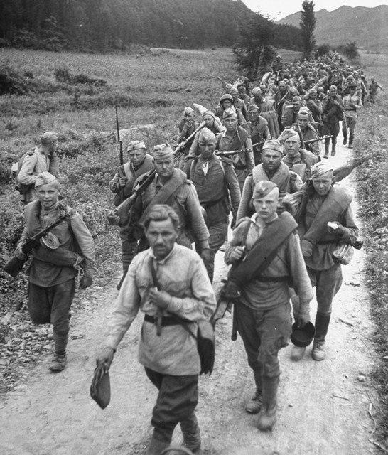 Soviet liberators marching through the Korean county road. October 1945